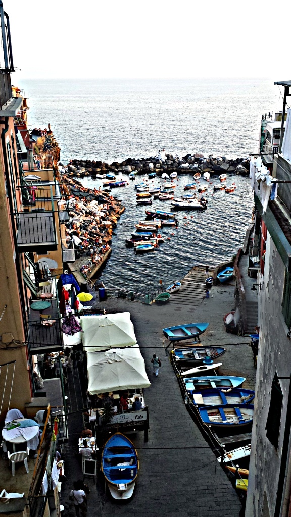 Riomaggiore in the Cinque Terre, Italy. Even when those boats are shoved into the harbour with no order, it looks perfectly planned.