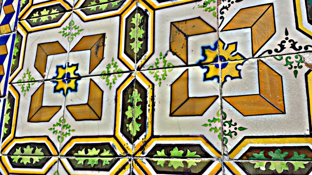 Tiles in Lisbon, Portugal. These designs line, it seems, the walls of every building in the country's capital city – even the streets and sidewalks, sometimes.